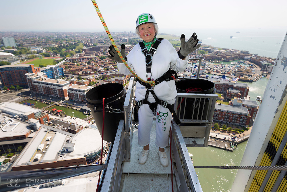 140518 ISON Doris Long Abseil  Intrepid centenarian Doris Long MBE steps out onto the platform before abseiling down the 130 metre tall Spinnaker Tower in Portsmouth today, on her 100th Birthday. She performed the feat to raise funds for local charity, The Rowans Hospice and it is her 15th abseil. Daring Doris took up abseiling at 85 and today broke her own record of being the oldest person to abseil. Picture date Sunday 18th May, 2014. Picture by Christopher Ison. Contact +447544 044177 chris@christopherison.com